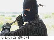 Купить «Robber with a crow bar», фото № 29996574, снято 29 июня 2012 г. (c) Wavebreak Media / Фотобанк Лори