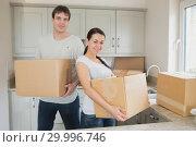 Купить «Two young people relocating», фото № 29996746, снято 29 июня 2012 г. (c) Wavebreak Media / Фотобанк Лори