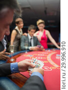 Купить «Man looking at his cards», фото № 29996910, снято 20 июля 2012 г. (c) Wavebreak Media / Фотобанк Лори