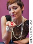 Купить «Dice being blown on by woman for luck», фото № 29997242, снято 20 июля 2012 г. (c) Wavebreak Media / Фотобанк Лори