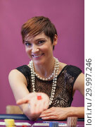 Купить «Woman in a casino holding dices», фото № 29997246, снято 20 июля 2012 г. (c) Wavebreak Media / Фотобанк Лори