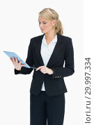 Купить «Blonde planning on her tablet», фото № 29997334, снято 18 июля 2012 г. (c) Wavebreak Media / Фотобанк Лори