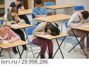 Купить «Girl sleeping during exam», фото № 29998286, снято 25 июля 2012 г. (c) Wavebreak Media / Фотобанк Лори
