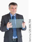 Купить «Cheerful man holding a pane», фото № 29998794, снято 31 июля 2012 г. (c) Wavebreak Media / Фотобанк Лори
