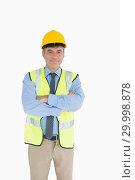 Купить «Man wearing hardhat and vest», фото № 29998878, снято 31 июля 2012 г. (c) Wavebreak Media / Фотобанк Лори