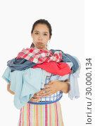 Купить «Tired woman holding full laundry basket», фото № 30000134, снято 8 августа 2012 г. (c) Wavebreak Media / Фотобанк Лори