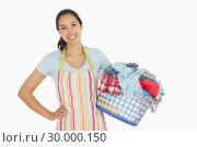 Купить «Happy woman with laundry basket», фото № 30000150, снято 8 августа 2012 г. (c) Wavebreak Media / Фотобанк Лори