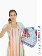 Купить «Laughing woman holding laundry basket full of dirty clothes», фото № 30000154, снято 8 августа 2012 г. (c) Wavebreak Media / Фотобанк Лори