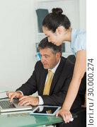 Купить «Business man and woman working on a laptop», фото № 30000274, снято 8 августа 2012 г. (c) Wavebreak Media / Фотобанк Лори
