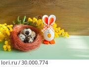 Купить «Easter background. Easter bunnies and Easter eggs in the box near the mimosa flowers», фото № 30000774, снято 27 февраля 2018 г. (c) Зезелина Марина / Фотобанк Лори