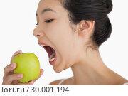 Купить «Woman biting into apple», фото № 30001194, снято 23 августа 2012 г. (c) Wavebreak Media / Фотобанк Лори