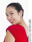 Купить «Woman in red dress looking over her shoulder», фото № 30001286, снято 23 августа 2012 г. (c) Wavebreak Media / Фотобанк Лори