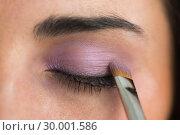 Купить «Woman getting eye shadow applied», фото № 30001586, снято 27 августа 2012 г. (c) Wavebreak Media / Фотобанк Лори