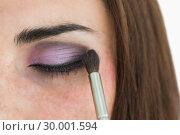 Купить «Pale woman getting smoky eyes», фото № 30001594, снято 27 августа 2012 г. (c) Wavebreak Media / Фотобанк Лори
