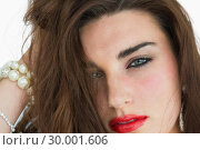 Купить «Woman with red lips wearing jewellery», фото № 30001606, снято 27 августа 2012 г. (c) Wavebreak Media / Фотобанк Лори