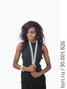 Купить «Woman wearing black dress and pearls», фото № 30001826, снято 27 августа 2012 г. (c) Wavebreak Media / Фотобанк Лори