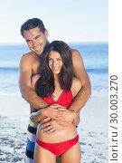 Купить «Happy couple in swimsuit hugging», фото № 30003270, снято 4 апреля 2013 г. (c) Wavebreak Media / Фотобанк Лори