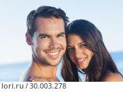 Купить «Happy couple posing together», фото № 30003278, снято 4 апреля 2013 г. (c) Wavebreak Media / Фотобанк Лори