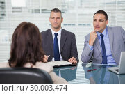 Купить «Serious businessmen having an interview», фото № 30003474, снято 7 апреля 2013 г. (c) Wavebreak Media / Фотобанк Лори