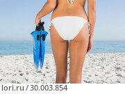 Купить «Perfect feminine buttocks of young woman holding fins», фото № 30003854, снято 4 апреля 2013 г. (c) Wavebreak Media / Фотобанк Лори