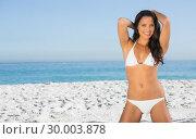 Купить «Smiling sexy woman in white bikini posing», фото № 30003878, снято 4 апреля 2013 г. (c) Wavebreak Media / Фотобанк Лори