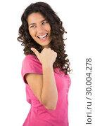 Купить «Dark haired young model posing thumb up», фото № 30004278, снято 17 апреля 2013 г. (c) Wavebreak Media / Фотобанк Лори