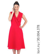 Купить «Cheerful elegant brunette in red dress on the phone posing», фото № 30004378, снято 17 апреля 2013 г. (c) Wavebreak Media / Фотобанк Лори