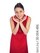 Купить «Surprised mysterious brunette in red dress posing», фото № 30004486, снято 17 апреля 2013 г. (c) Wavebreak Media / Фотобанк Лори