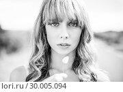 Купить «Black and white photograph of sexy natural blonde », фото № 30005094, снято 26 апреля 2013 г. (c) Wavebreak Media / Фотобанк Лори