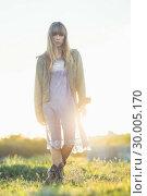 Купить «Fashionable young girl in sheer dress and jacket», фото № 30005170, снято 26 апреля 2013 г. (c) Wavebreak Media / Фотобанк Лори