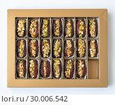Купить «Dates stuffed with pistachios in a box», фото № 30006542, снято 13 апреля 2018 г. (c) Володина Ольга / Фотобанк Лори
