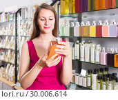 Купить «woman take a choise fresh liquid soap in perfume supermarket», фото № 30006614, снято 2 мая 2017 г. (c) Яков Филимонов / Фотобанк Лори