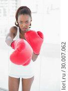 Купить «Slender athletic woman boxing», фото № 30007062, снято 7 июня 2013 г. (c) Wavebreak Media / Фотобанк Лори