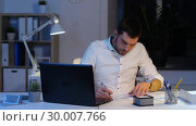 Купить «businessman with papers and laptop at night office», видеоролик № 30007766, снято 11 февраля 2019 г. (c) Syda Productions / Фотобанк Лори