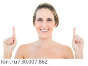 Купить «Smiling blonde woman pointing up», фото № 30007862, снято 5 июня 2013 г. (c) Wavebreak Media / Фотобанк Лори