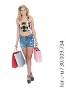 Купить «Delighted retro blonde model carrying shopping bags», фото № 30009734, снято 6 июня 2013 г. (c) Wavebreak Media / Фотобанк Лори