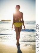 Купить «Rear view of gorgeous woman in bikini», фото № 30010230, снято 9 мая 2013 г. (c) Wavebreak Media / Фотобанк Лори