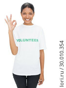 Купить «Smiling model wearing volunteer tshirt making okay gesture», фото № 30010354, снято 24 мая 2013 г. (c) Wavebreak Media / Фотобанк Лори
