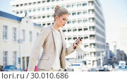 Купить «Focused gorgeous businesswoman text messaging», фото № 30010686, снято 11 июня 2013 г. (c) Wavebreak Media / Фотобанк Лори