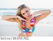 Купить «Sexy peaceful blonde in bikini wearing hawaii necklace posing», фото № 30010762, снято 11 июня 2013 г. (c) Wavebreak Media / Фотобанк Лори