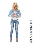 Купить «Serious casual blonde wearing denim clothes posing», фото № 30012454, снято 15 мая 2013 г. (c) Wavebreak Media / Фотобанк Лори