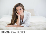 Купить «Pretty casual brown haired woman in white pajamas lying on her bed», фото № 30013454, снято 18 июня 2013 г. (c) Wavebreak Media / Фотобанк Лори