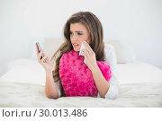 Купить «Sad casual brown haired woman in white pajamas looking at her mobile phone and crying», фото № 30013486, снято 18 июня 2013 г. (c) Wavebreak Media / Фотобанк Лори
