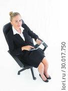 Купить «Smiling cute businesswoman sitting on her office chair», фото № 30017750, снято 28 июня 2013 г. (c) Wavebreak Media / Фотобанк Лори