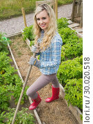 Купить «Blonde young woman working with a rake», фото № 30020518, снято 4 июля 2013 г. (c) Wavebreak Media / Фотобанк Лори