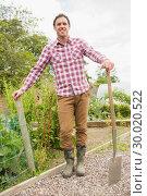 Купить «Proud young man wearing a check shirt posing», фото № 30020522, снято 4 июля 2013 г. (c) Wavebreak Media / Фотобанк Лори