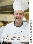 Купить «Happy chef presenting plate of meringues», фото № 30020954, снято 14 августа 2013 г. (c) Wavebreak Media / Фотобанк Лори