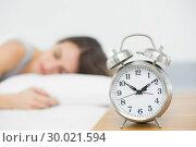 Купить «Retro alarm clock standing on bedside table », фото № 30021594, снято 3 июля 2013 г. (c) Wavebreak Media / Фотобанк Лори