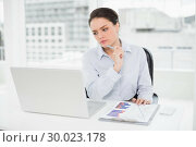 Купить «Businesswoman with graphs and laptop in office», фото № 30023178, снято 16 июля 2013 г. (c) Wavebreak Media / Фотобанк Лори