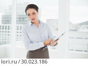 Купить «Elegant businesswoman with graphs in office», фото № 30023186, снято 16 июля 2013 г. (c) Wavebreak Media / Фотобанк Лори